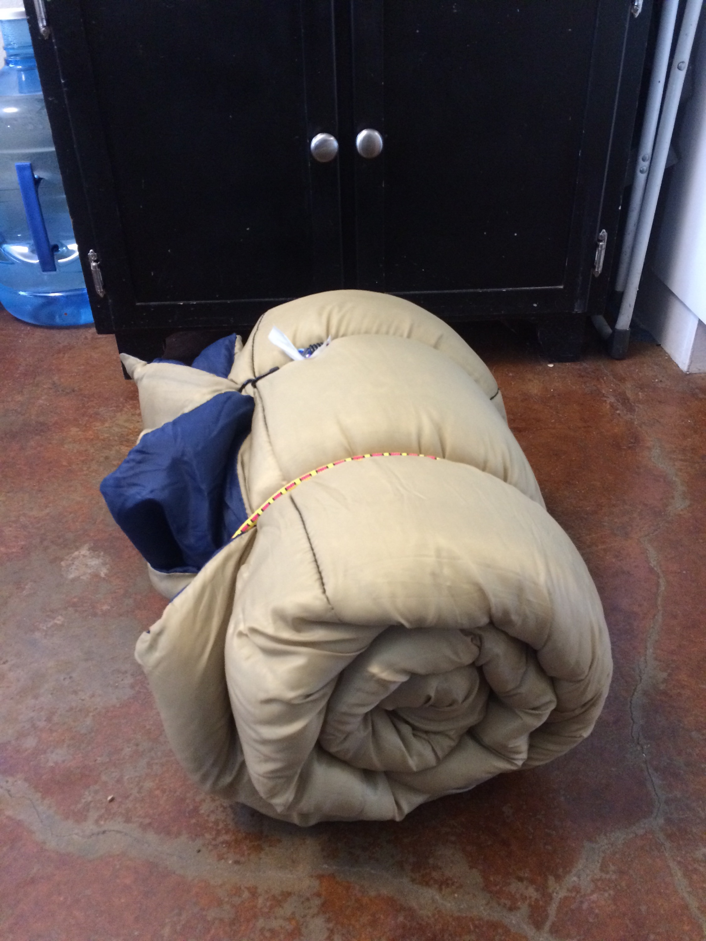 rolled adult sized sleeping bag